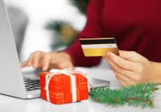 Young woman ordering Christmas gifts online